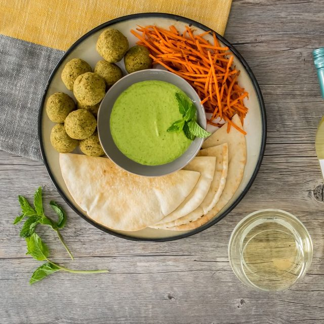 Falafel gets lightened up with the addition of @alaskaseafood pollock, tucked into pita with mint hummus and harissa carrots on the side. Link in bio. #Ad #NationalSeafoodMonth