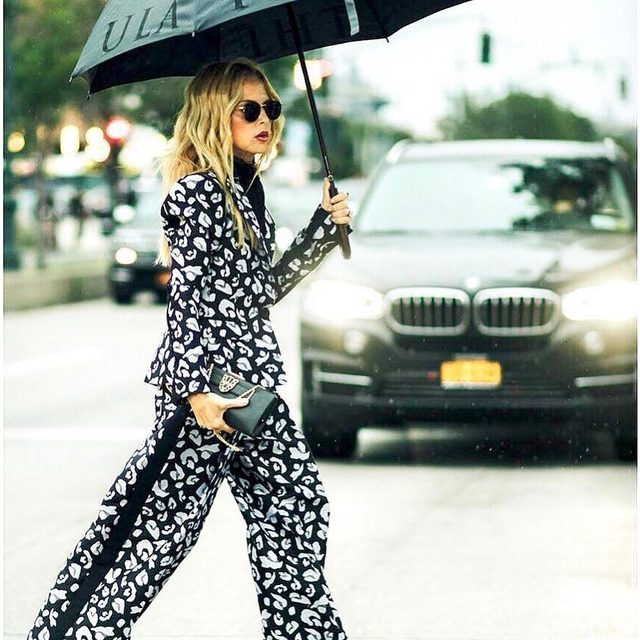 Rain or shine in our snow leopard suit | shoppable now at the link in our bio