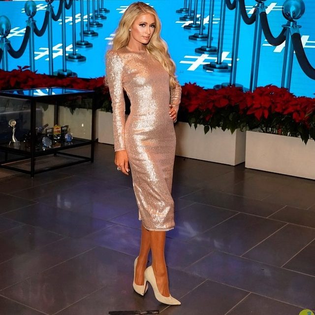 Living for @parishilton in our Jeane sequin midi dress | shop the look now at the link in our bio