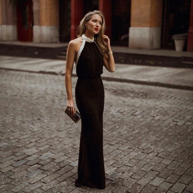 Holiday glamour by @maryorton 🖤| shop our Alison pearl embellished gown now at the link in our bio