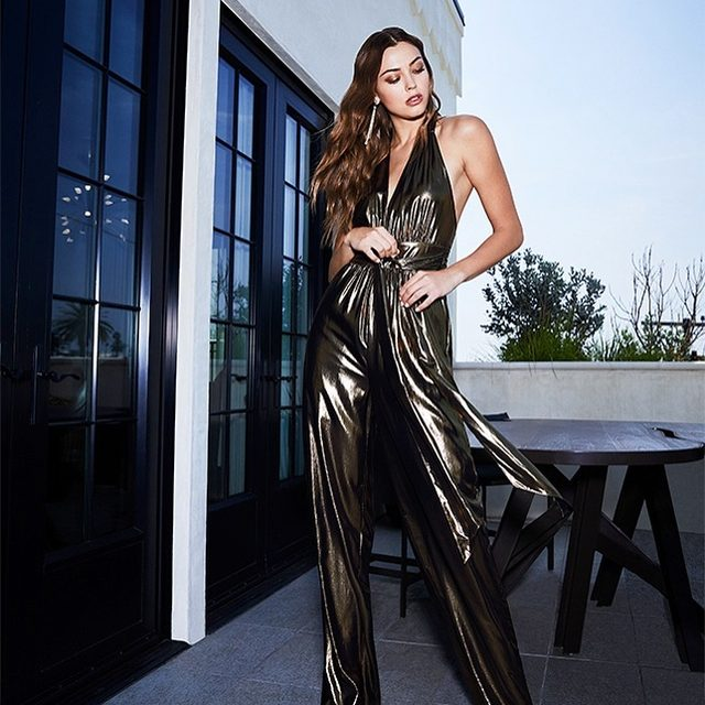 Channel disco-era glamour in our gold lamé jumpsuit✨| shoppable now at the link in our bio